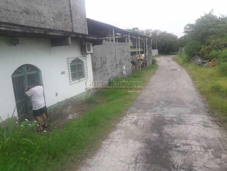 Foto 2 - Mini Estaleiro de 5.000 m2 podendo dobrar a área, 3 galpões grandes, escritório, cozinha, alojamento, varios banheiros e estacinamento para caminhões. Acesso por terra e por mar, fundos para a baia da Guanabara. - GIOU00002 - 4